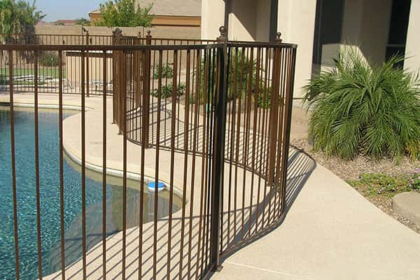 Wrought Iron Pool Safety Fence Following the Deck