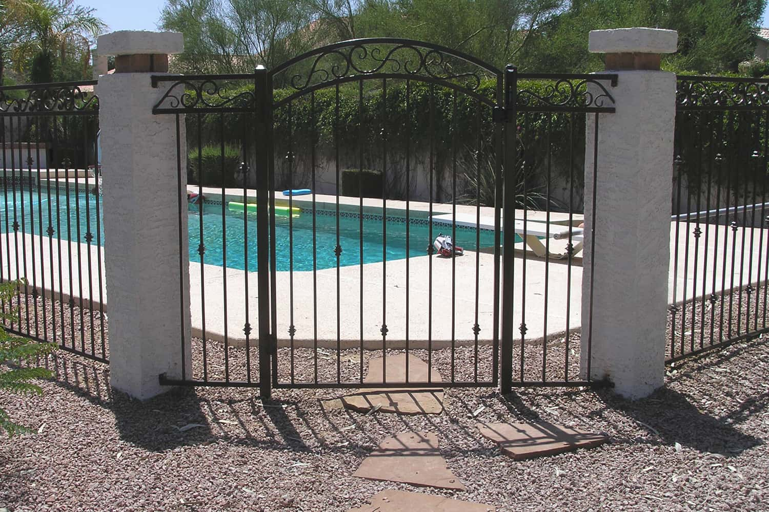 3-Rail Pool Fence with Arched Decorative Gate & Decorative Iron Pool Fencing Examples | Sun King Fencing