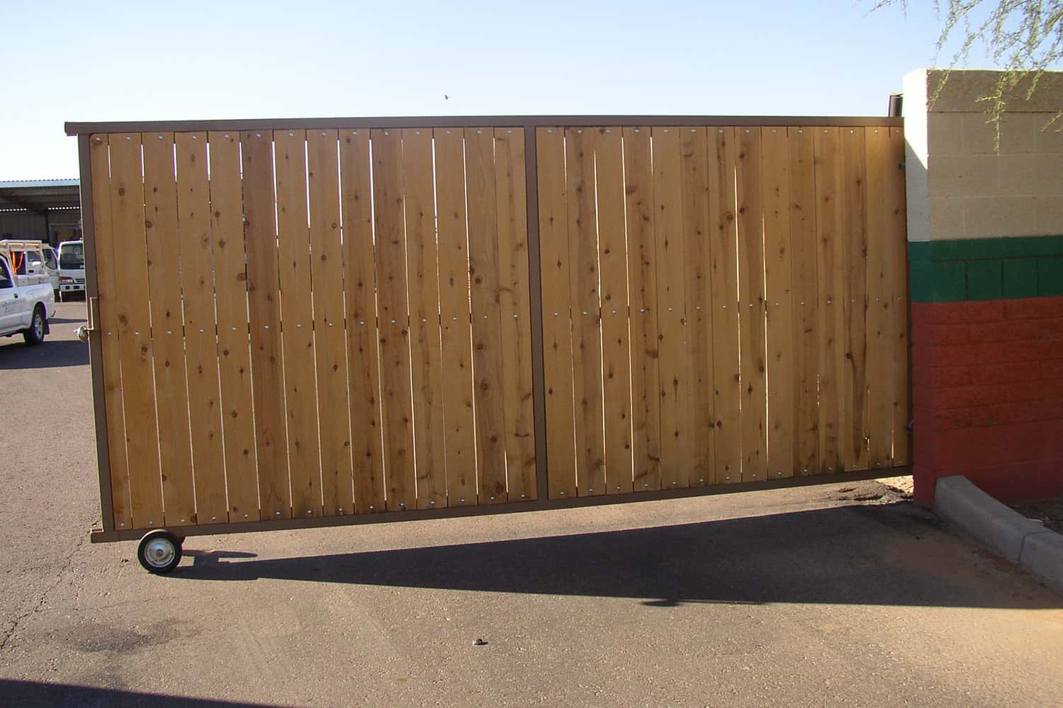 Rolling Driveway Gate with White Cedar Wood Privacy Slats