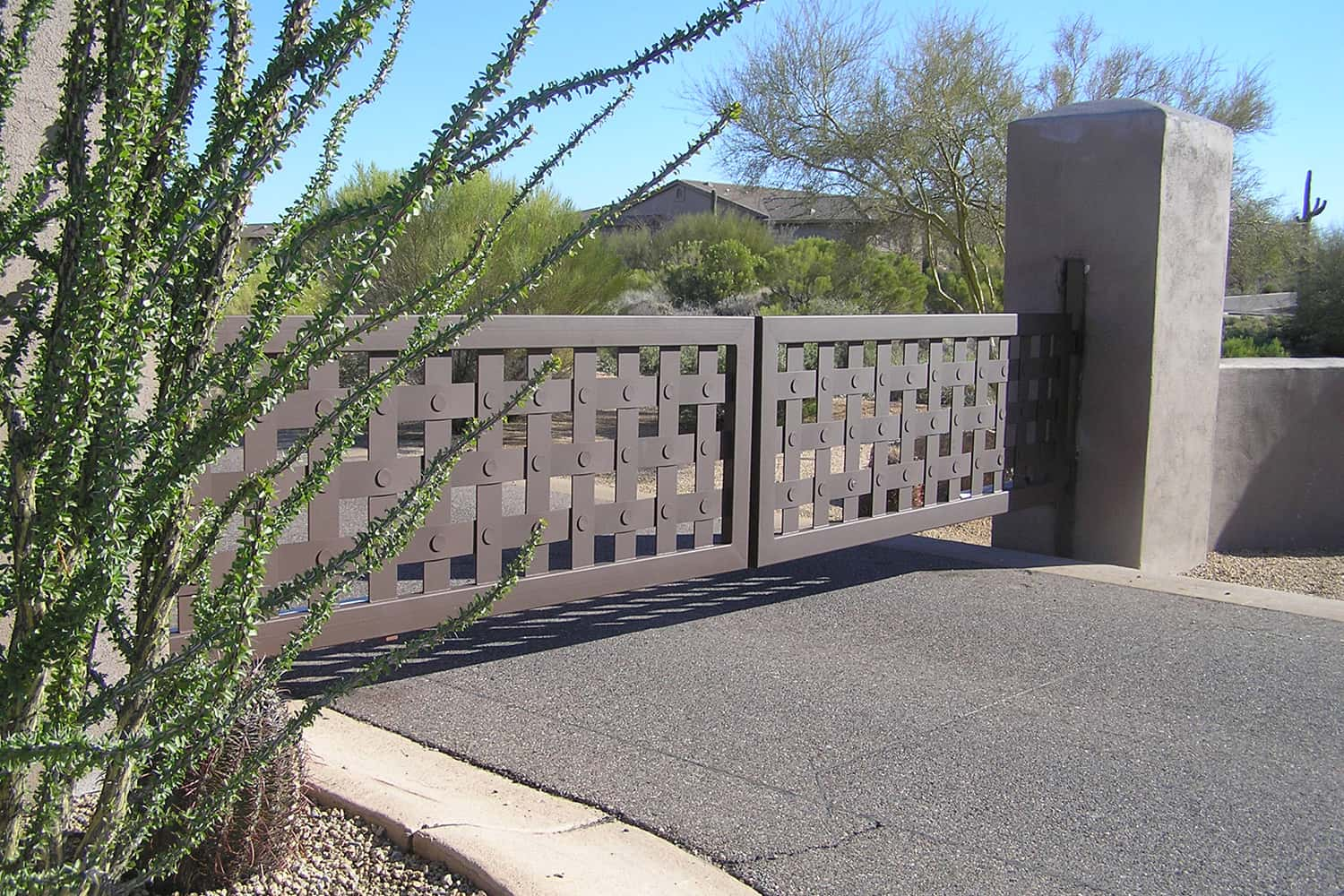 Side View of Decorative Driveway Gate with Basket Design