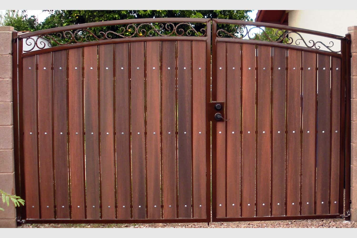 Decorative Arched RV Gate with Rust and Redwood